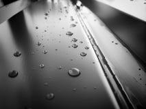 Vatten- och metallting Arkivbild