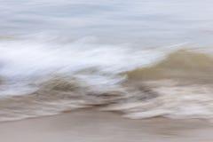Vatten- och sandabstrakt begrepp arkivfoton