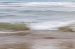 Vatten- och sandabstrakt begrepp royaltyfri bild