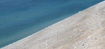 Vatten- och sandbakgrund i Diagonal Royaltyfri Fotografi