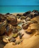 Vatten på en strand i Nya Zeeland Royaltyfria Bilder