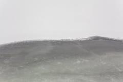 Vatten, snö och is Arkivfoto