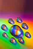 Vattendroppar på dvdmassmedia arkivfoto