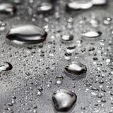 Vattendroppar/vätskemetall Arkivbilder