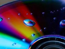 Vattendroppe på CD royaltyfria bilder