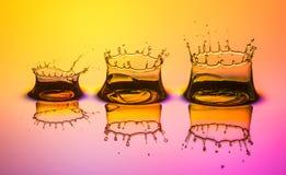 Vattendroppfärgstänk Arkivfoton