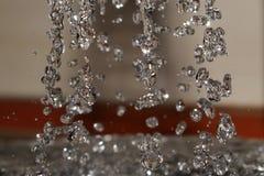 Vattendroppfärgstänk i vattnet Royaltyfria Bilder