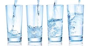 Vattenexponeringsglas på en vit bakgrund Royaltyfria Bilder