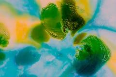 Vattenfärg med gräsplan, blått och guling fotografering för bildbyråer