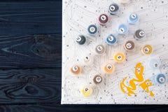 Vattenfärg och färgläggning vid nummer måla på kanfas vid nummer Royaltyfria Foton