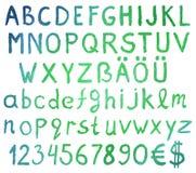 Vattenfärgalfabetbokstäver med nummer Arkivfoto