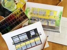 Vattenfärgen skissar av hus på tabellen Fotografering för Bildbyråer