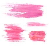 Vattenfärgmålarfärgfläckar Rosa färgslaglängder och fläckar Uppsättning av konstnärliga texturer Arkivbild