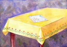 Vattenfärgmålningtabell med den gula torkduken och ett broderat n Royaltyfria Foton