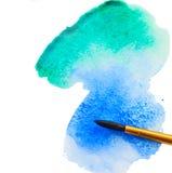Vattenfärgslaglängd med borsten Arkivfoto