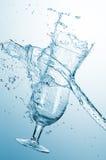Vattenfärgstänk med exponeringsglas Fotografering för Bildbyråer