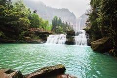 Vattenfall i berg på Chongqing Arkivbild