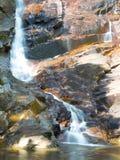 Vattenfall och solljus Royaltyfri Bild