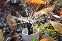 Vattenkran för vattensprej arkivfoto