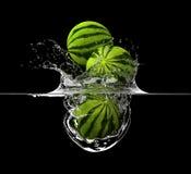 Vattenmelon i flytande Fotografering för Bildbyråer