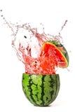 Vattenmelon med färgstänk Arkivbild