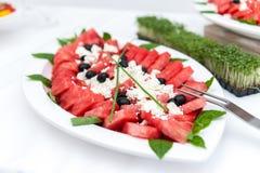 Vattenmelon och ostplatta royaltyfria foton