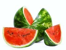 Vattenmelon och två skivor Arkivbilder