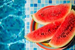 Vattenmelon på den blåa pölen Fotografering för Bildbyråer