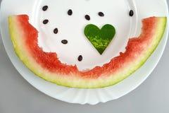 Vattenmelon på plattan Royaltyfri Bild