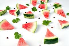 Vattenmelonmodell Skivad vattenmelon på vit bakgrund Fotografering för Bildbyråer