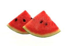 Vattenmelonskiva på vit bakgrund Fotografering för Bildbyråer