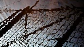Vattenreflexion av ett staket arkivbild