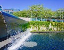 Vattensärdraget i stads- parkerar Arkivbild