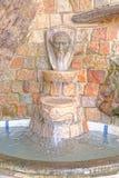 Vattenspringbrunn, lamor, Peru Arkivfoto