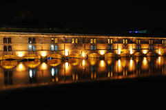 Vauban Dam in Strasbourg. Night view of Vauban Dam in Strasbourg, France done with long exposure Stock Photo