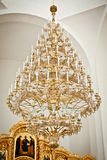 Vault in church with brass chandelier. Vault in golden church with brass chandelier Stock Image
