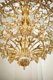 Vault in church with brass chandelier. Vault in golden church with brass chandelier Royalty Free Stock Images