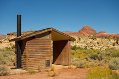 A vault toilet in the desert Stock Photography