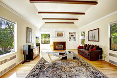 Vaulted ceiling with  brown beams in living room Royalty Free Stock Photos
