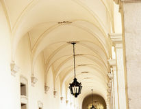 Vaulted ceiling with ornate iron lamp Royalty Free Stock Photo
