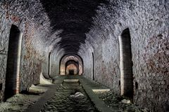 Vaulted corridor of the old German fortification structure of red brick.  Royalty Free Stock Photo