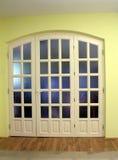 Vaulted door. And wooden floor_yellow wall royalty free stock photos