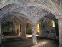 Vaulted Undercroft at Medieval Lanercost Priory, Cumbria, England. The medieval storage room at Lanercost Priory at Hadrian`s Wall in Cumbria is a perfect Royalty Free Stock Image