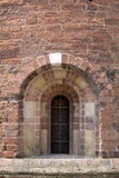 Vaulted window in romanesque-style church. Stock Photo