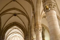 Vaults and columns in the church Stock Images