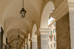 Vaults and pillars of covered walkway, Chiavari , Italy. Vaults and pillars of old covered walkway,  shot at Mediterranean little town of Chiavari, Genova Stock Photos