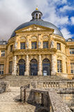 Vaux-le-Vicomte, France. The central part of the facade of the main building of of the estate. Vaux-le-Vicomte - classic French manor-palace of of the XVII Stock Photography