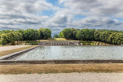 Vaux-le-Vicomte, France. Pond in the park. Vaux-le-Vicomte - classic French manor-palace of of the XVII century, situated 55 km south-east of Paris. It was built Royalty Free Stock Photos