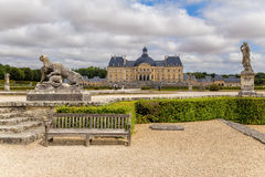 Vaux-le-Vicomte, France. Sculptures in the park and the central structure of manor Royalty Free Stock Photography