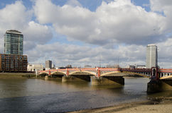 Vauxhall Bridge over River Thames. The Victorian cast iron Vauxhall Bridge crossing the River Thames in Central London Stock Photo